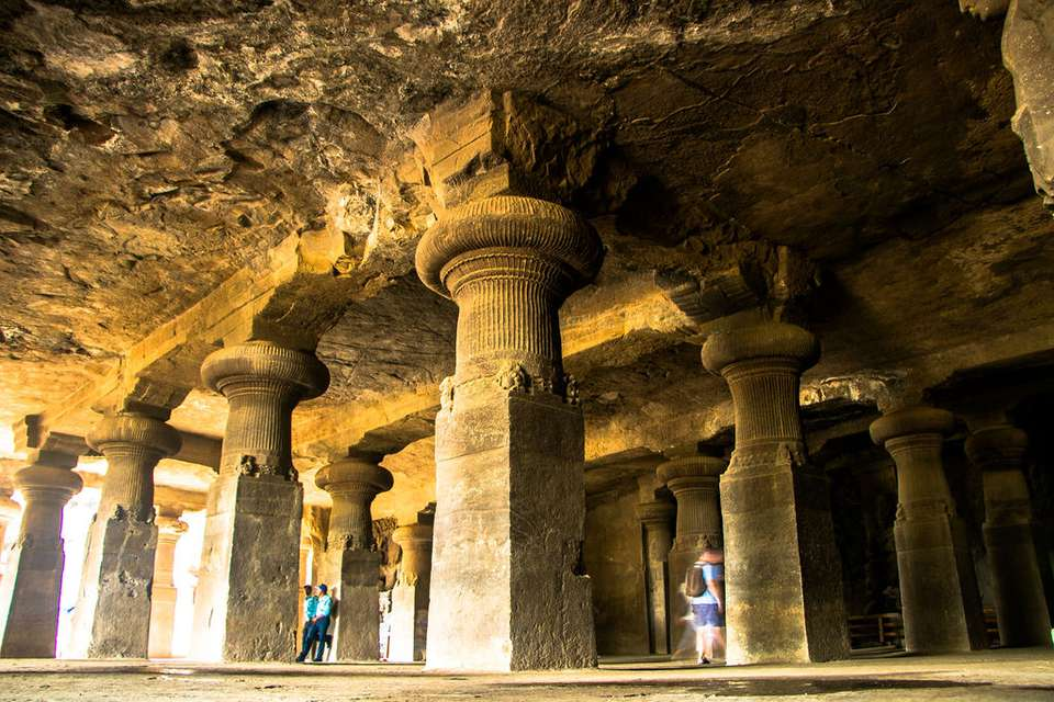 Large pillars carved out inside the elephanta caves