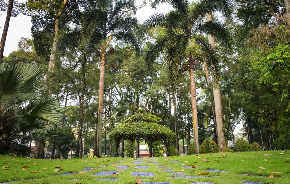 A green gazebo and trees in one of Ho Chi Minh City's parks