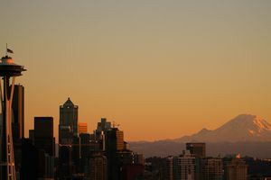 View of The Space Needle and Mt Rainier during sunset