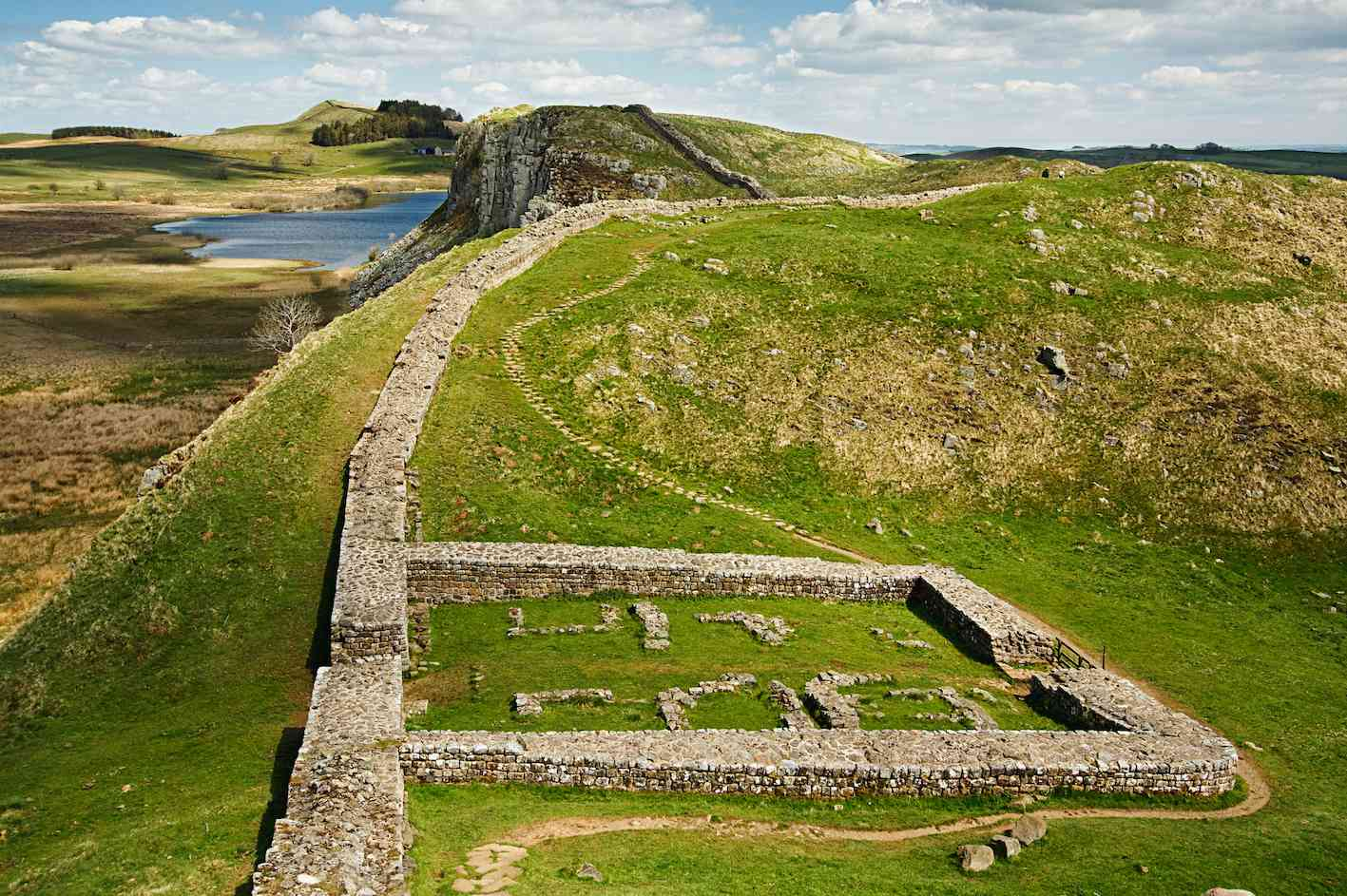 Aerial view of Hadrian's Wall and a ruined Roman castle, UK