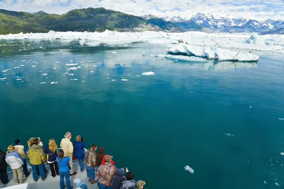 Tourist Viewing Icebergs From A Boat On A Tour To Columbia Glacier Out Of Valdez, Alaska
