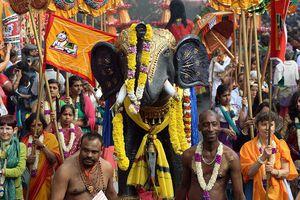 People parade to celebrate the elephant-headed Hindu deity Ganesh