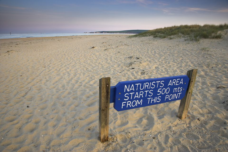 nude beach at Studland Bay in Dorset is posted with blue signs and green posts