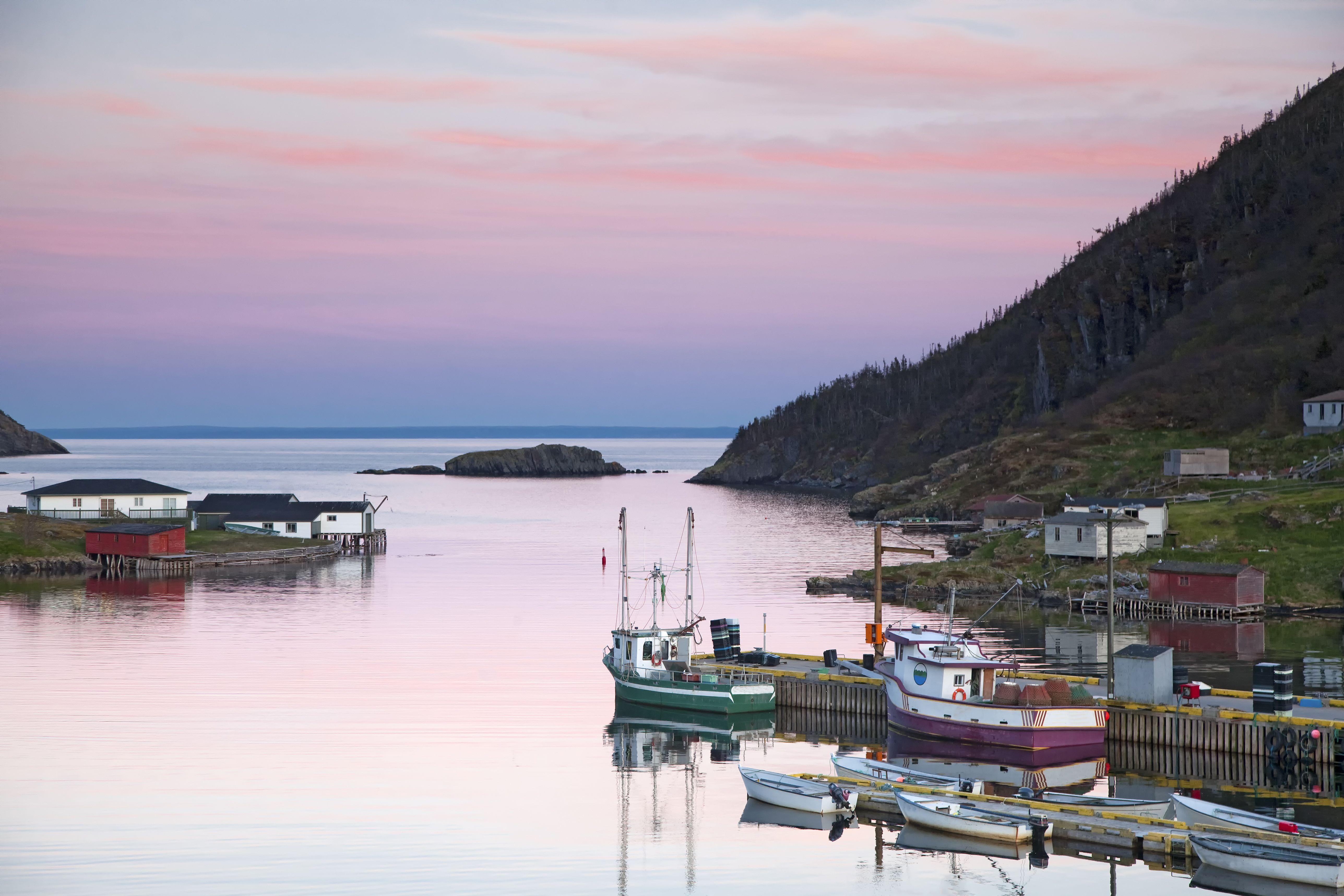 Boats mooring in calm bay