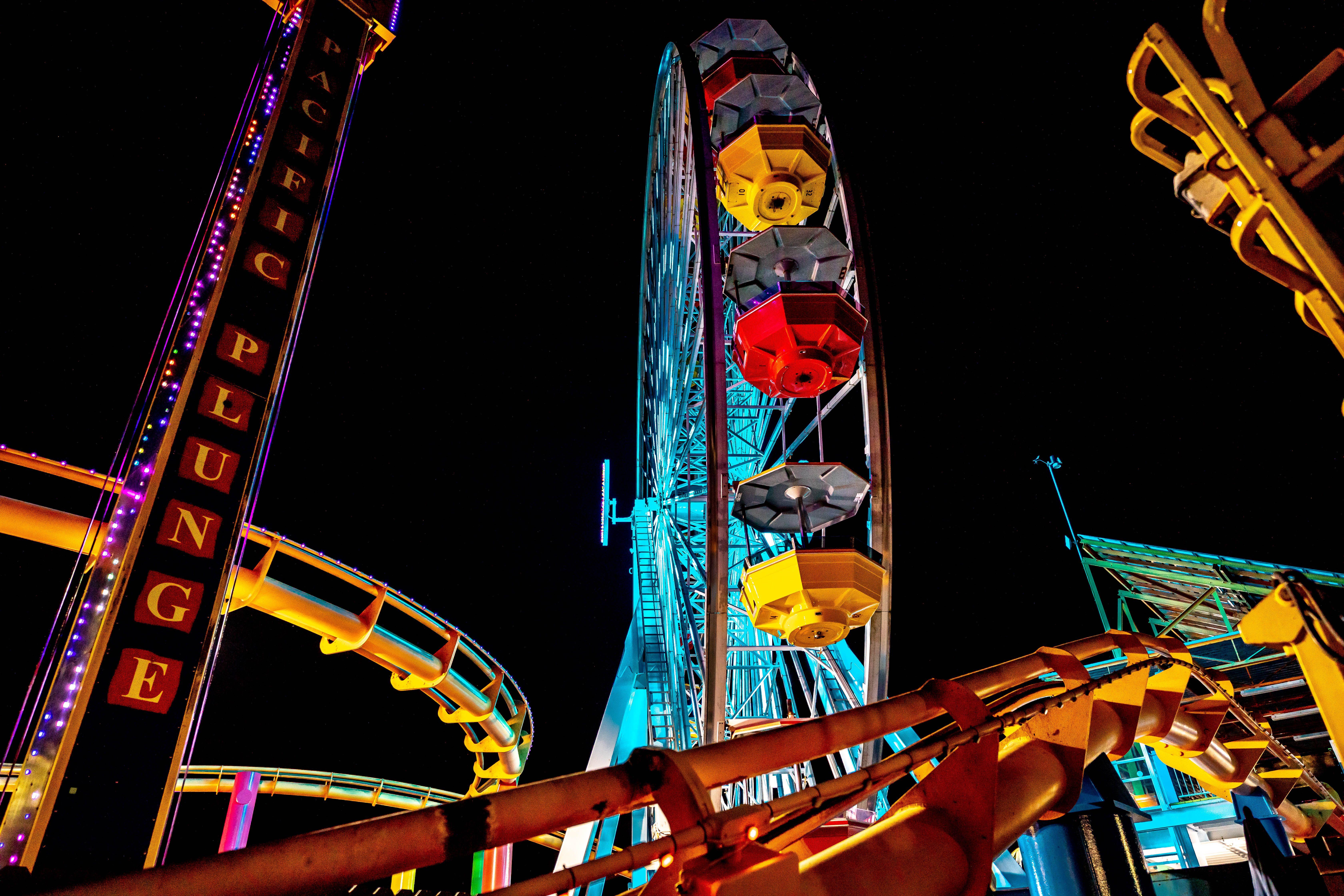 The Santa Monica Pier lit up at night