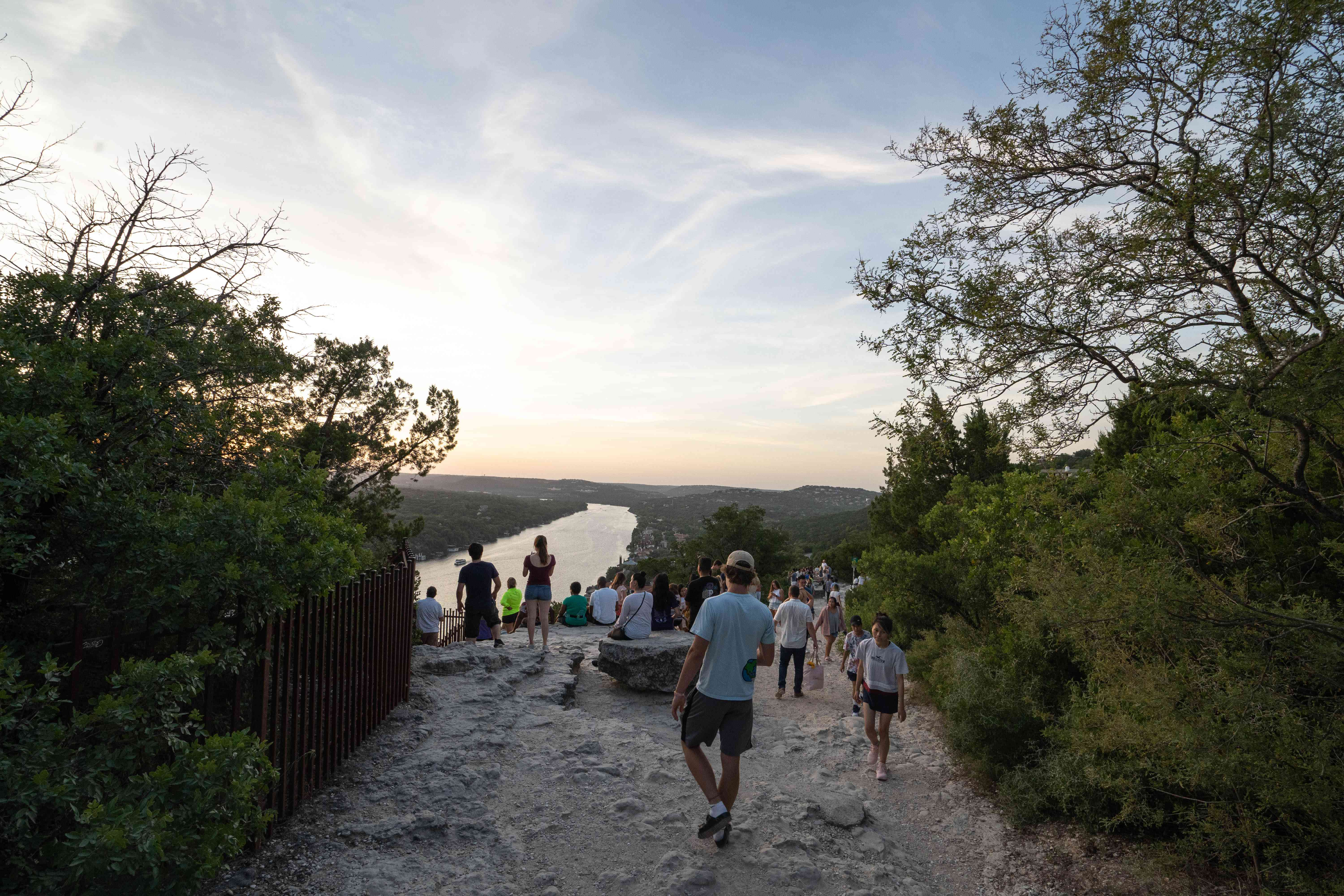 People enjoying the view from the top of Mount Bonnell