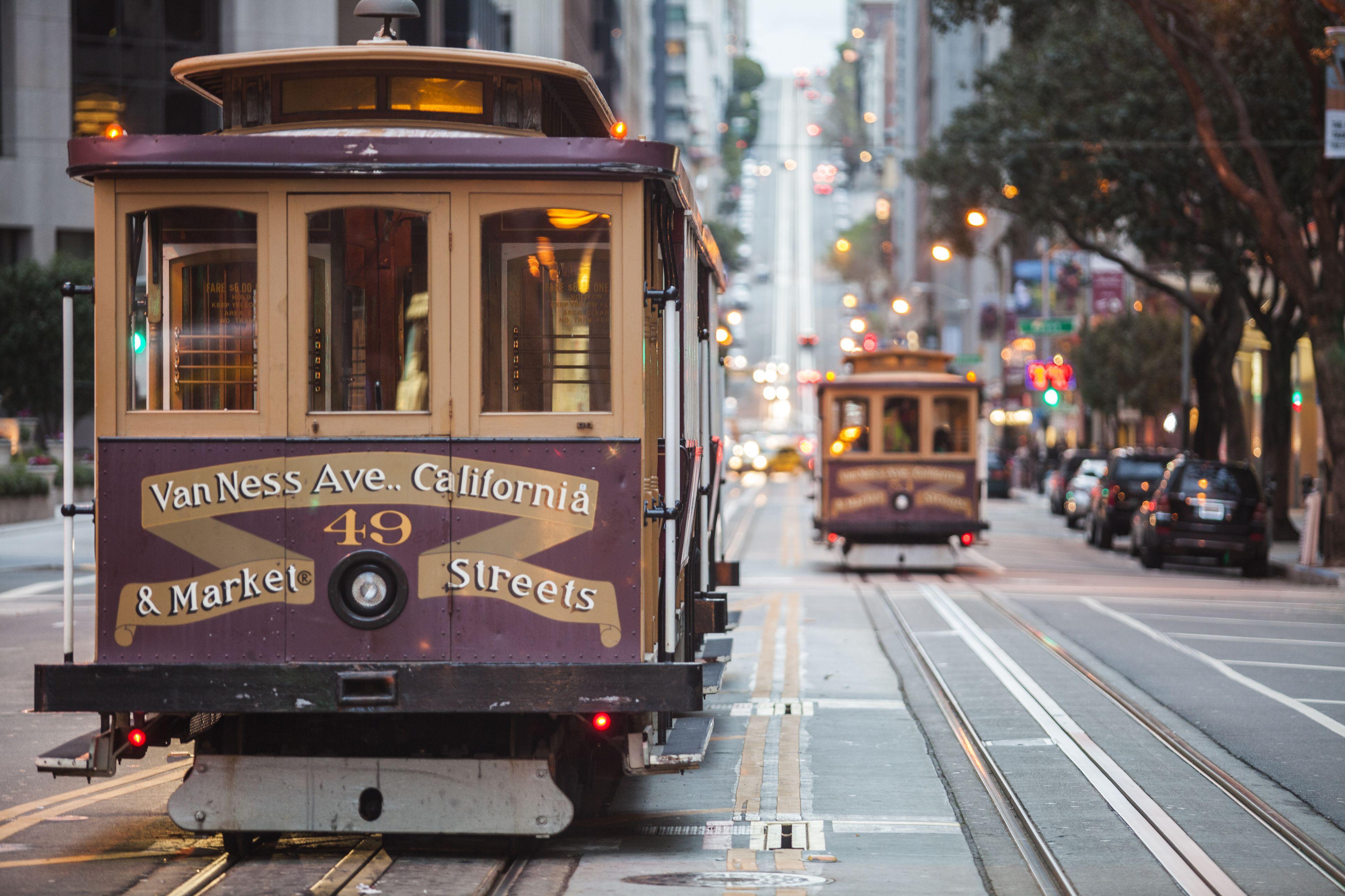 1cd9ec1b Cable cars on city street, San Francisco, California, USA