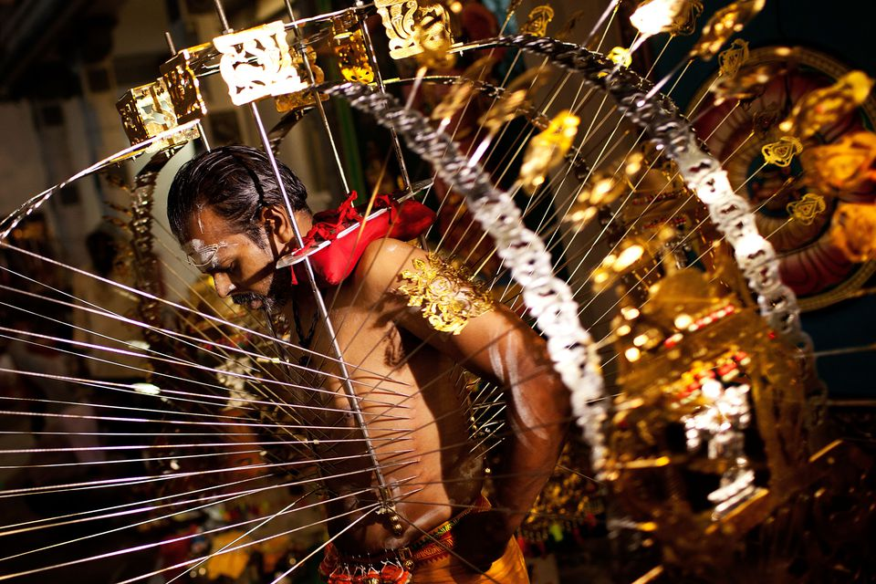 Man carrying a kavadi during the Thaipusam festival