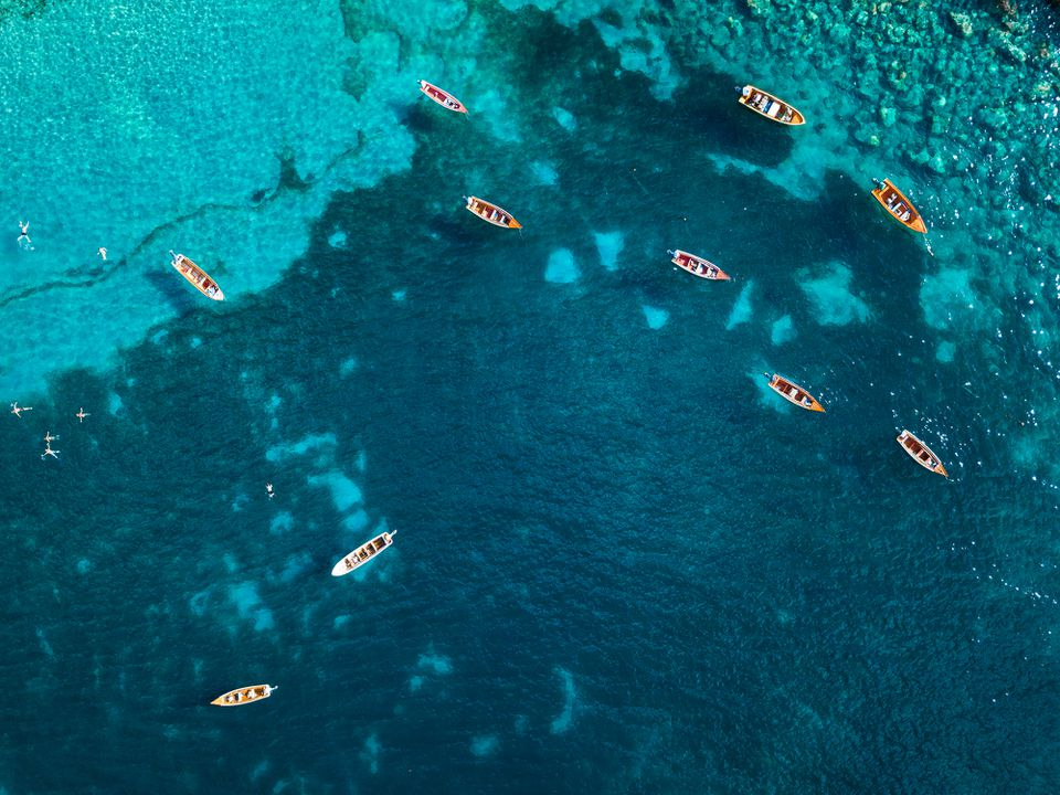 High angle view of fishing boats floating on the Caribbean Sea, Anse Dufour, Martinique