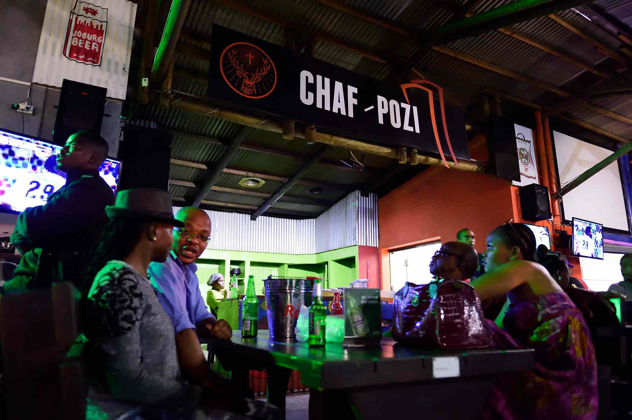 Bar patrons in Chaf Pozi shisa nyama, Soweto