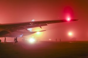 Wing of an airplane in the evening fog at Casablanca Airport