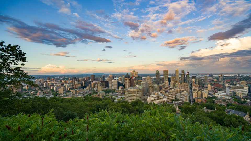 View of Montreal Cityscape Against Cloudy Sky
