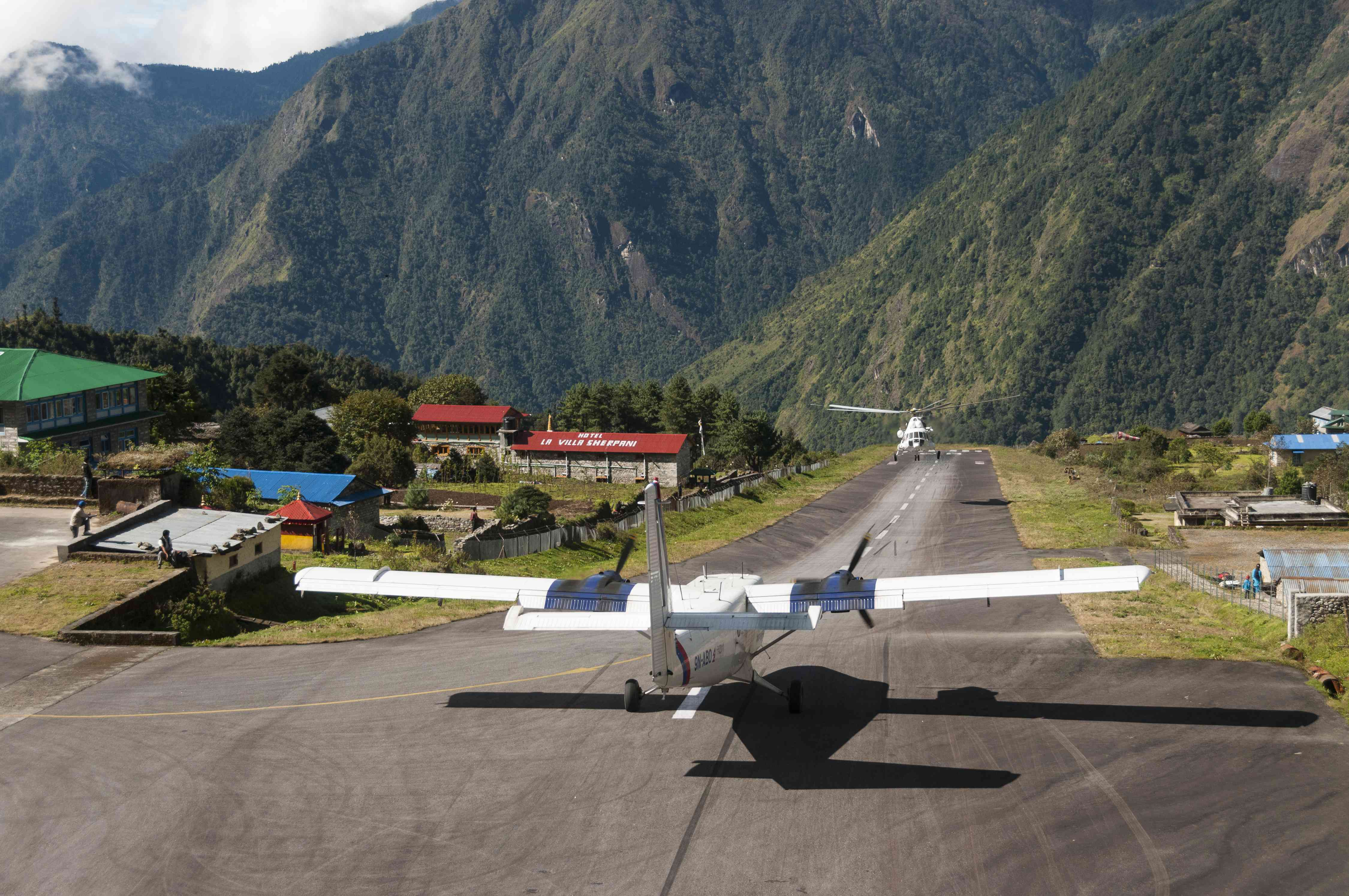 Plan taking off from Lukla Airport in the Himalayas