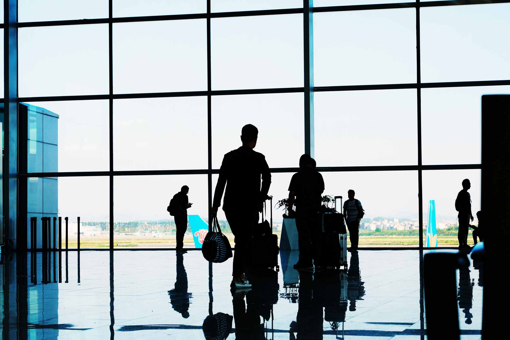 Silhouettes of people departing at the airport Indonesia