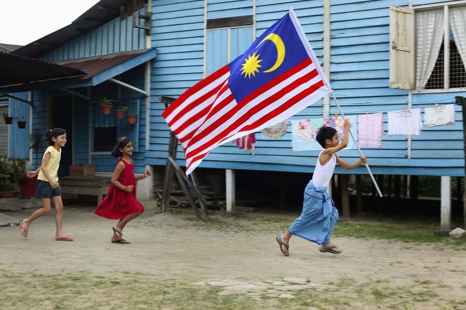 Boy running with flag in hands, girls running behind him, Full Length, Side View