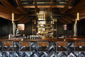 Wraparound wooden bar at Sagamore Hill Lounge in portland maine