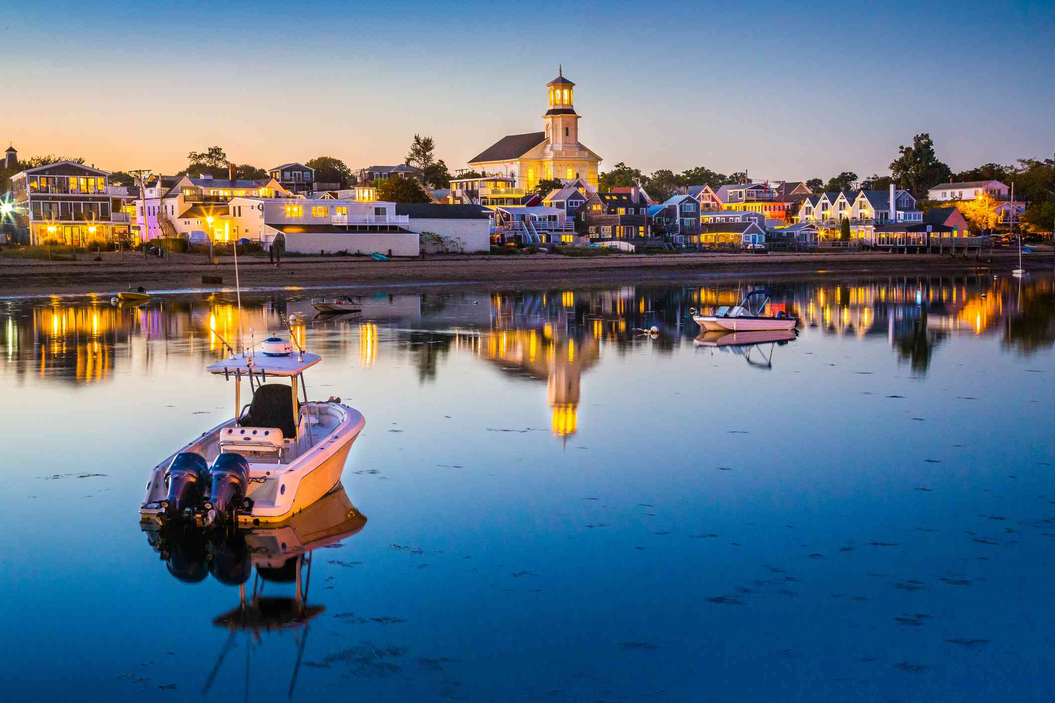 The busy waterfront of charming Provincetown with the glow of blue hour