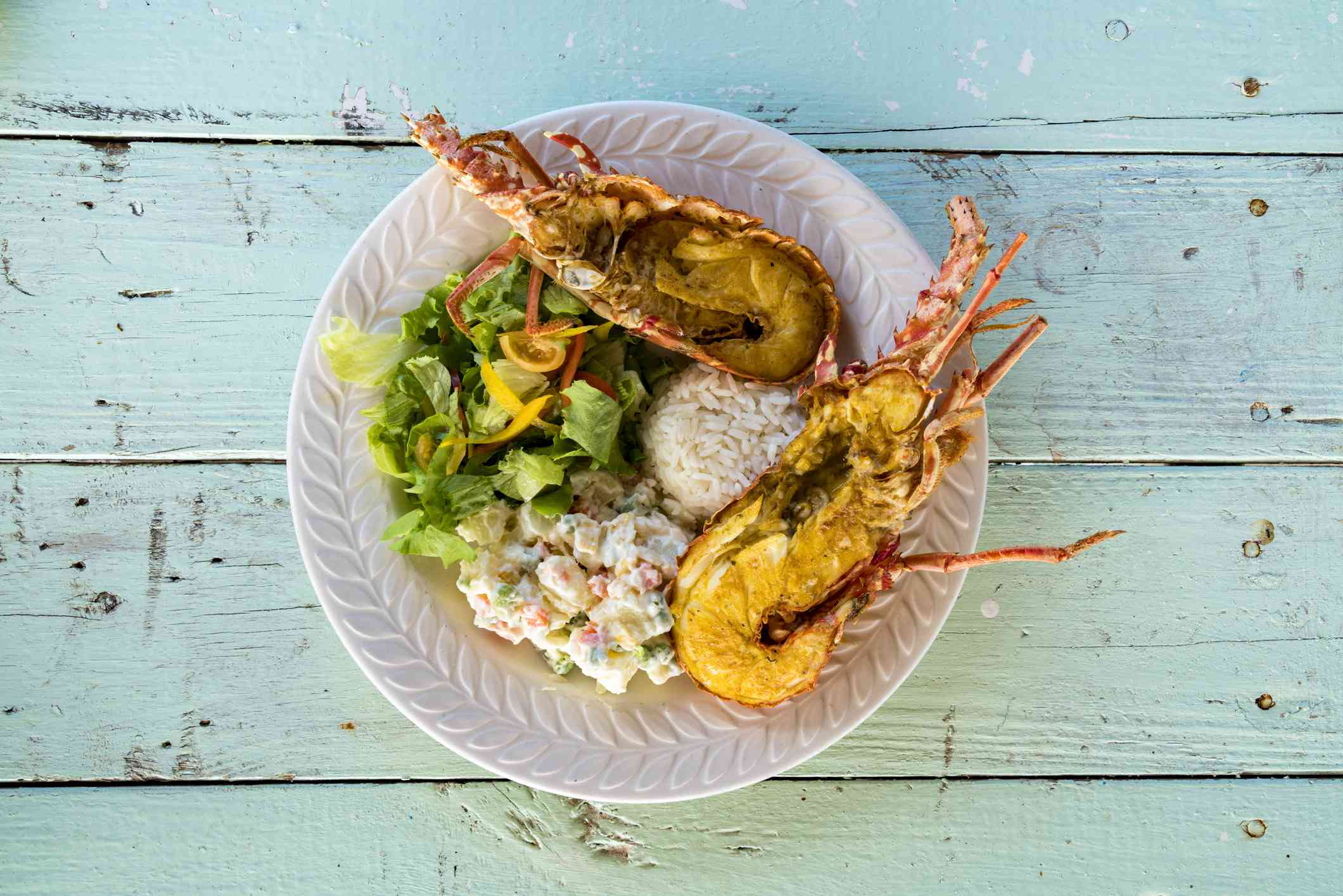 Dish with fresh lobster, rice and vegetables, Caribbean