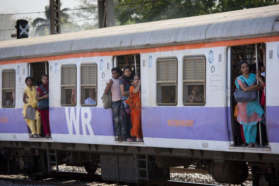 470003ffcd Female workers on crowded commuter train of Western Railway near Mahalaxmi  Station on the Mumbai Suburban
