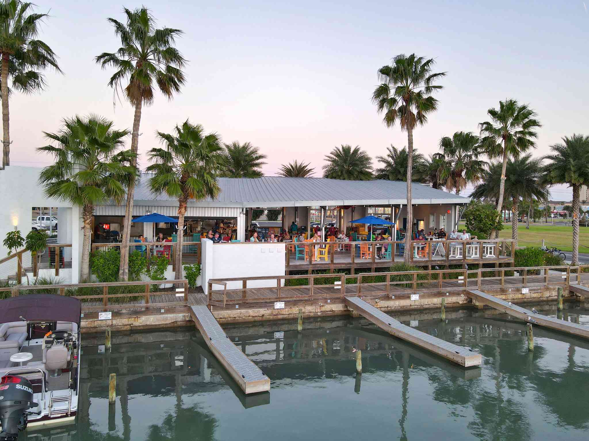 Palm trees surround the restaurant, right on the water
