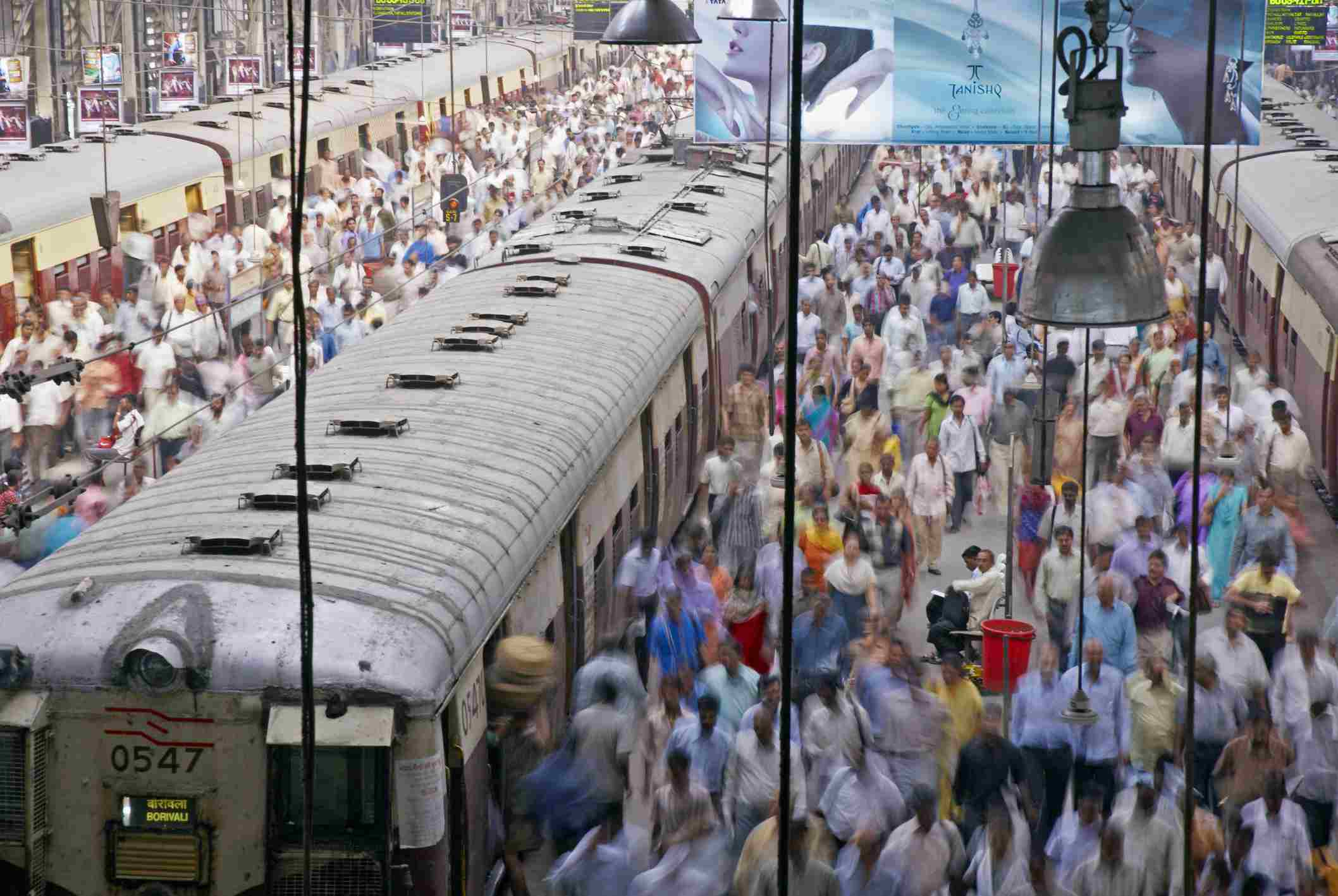 India, Mumbai, Churchgate Station, trains and platforms packed with commuters