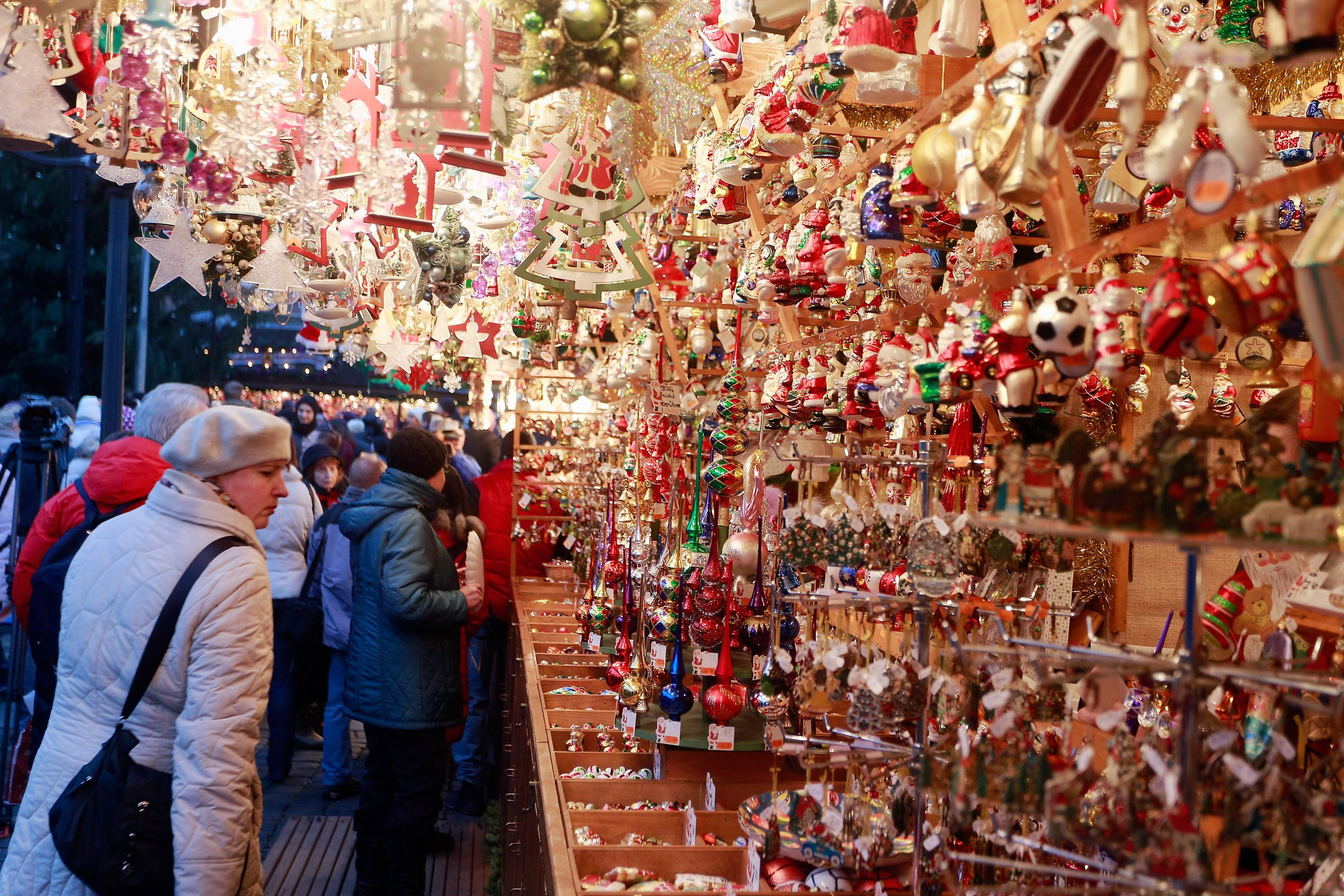 Visitors look at Christmas decorations for sale at the traditional Christmas market 'Nuernberger Christkindlesmarkt' ahead of the opening ceremony in Nuremberg, Germany..