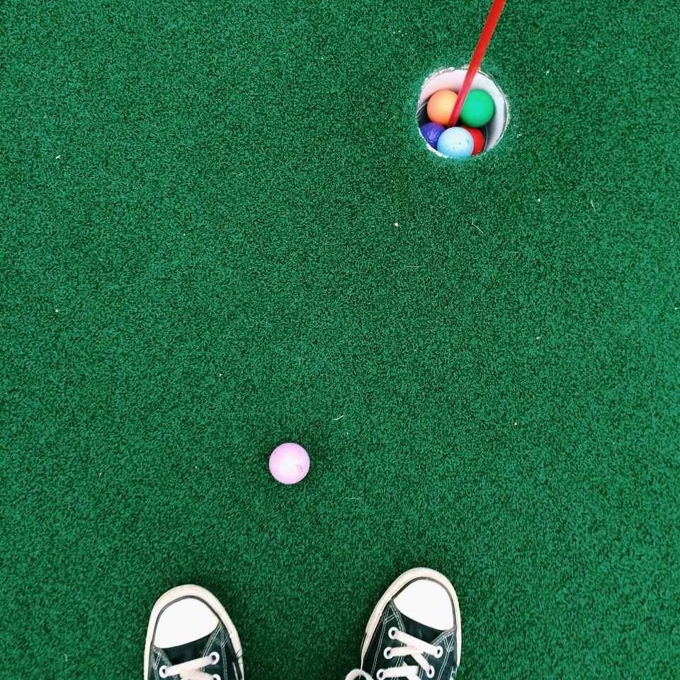 Feet on putting green