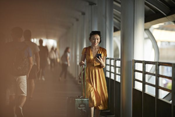 woman in airport on phone