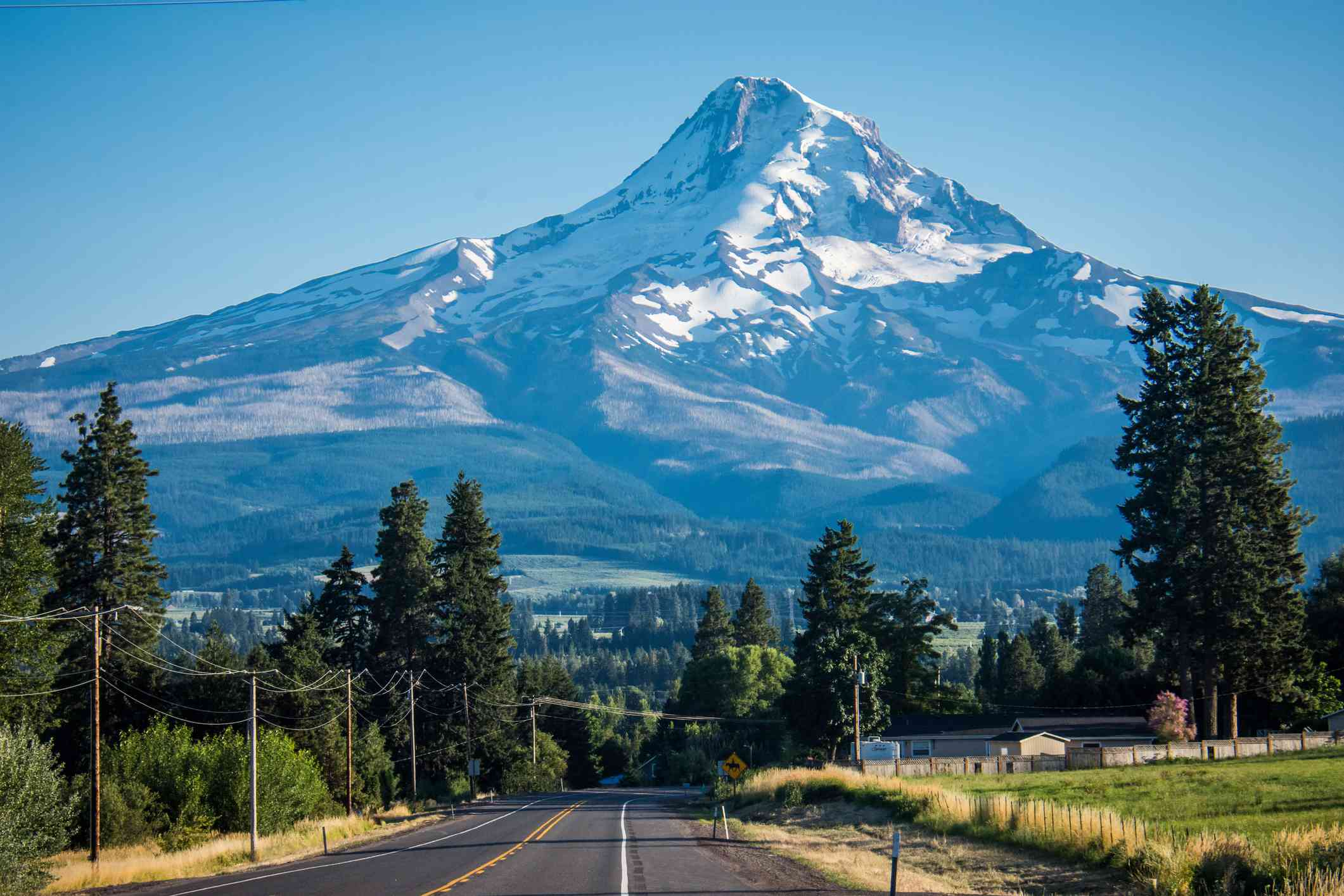 The road through Mt. Hood's Fruit Loop with Mt. Hood mountain looming in the background in Oregon