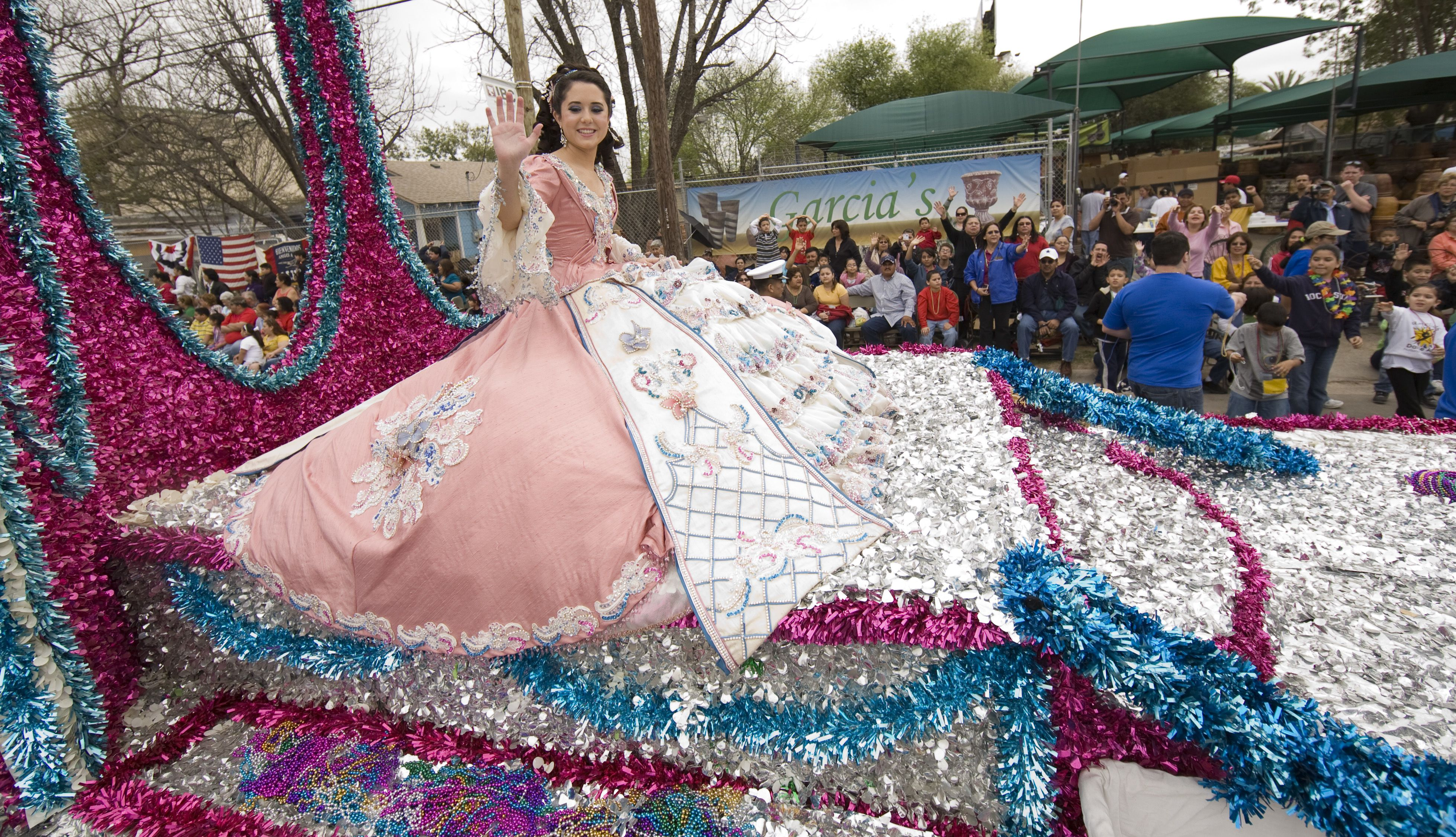Girl in extravagant pink traditional dress on a parade float during the celebration of George Washington's birthday