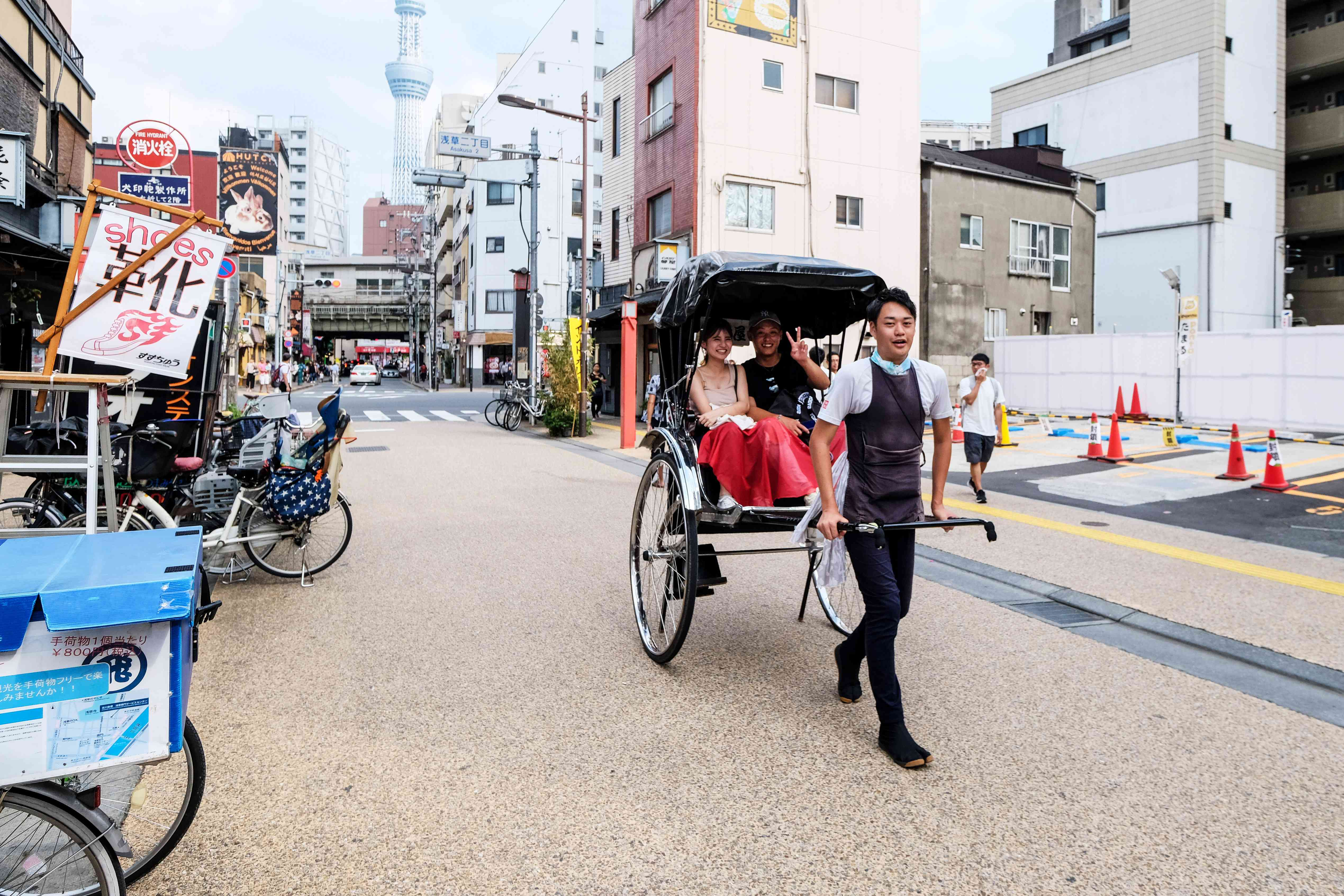 Two people riding in a rickshaw