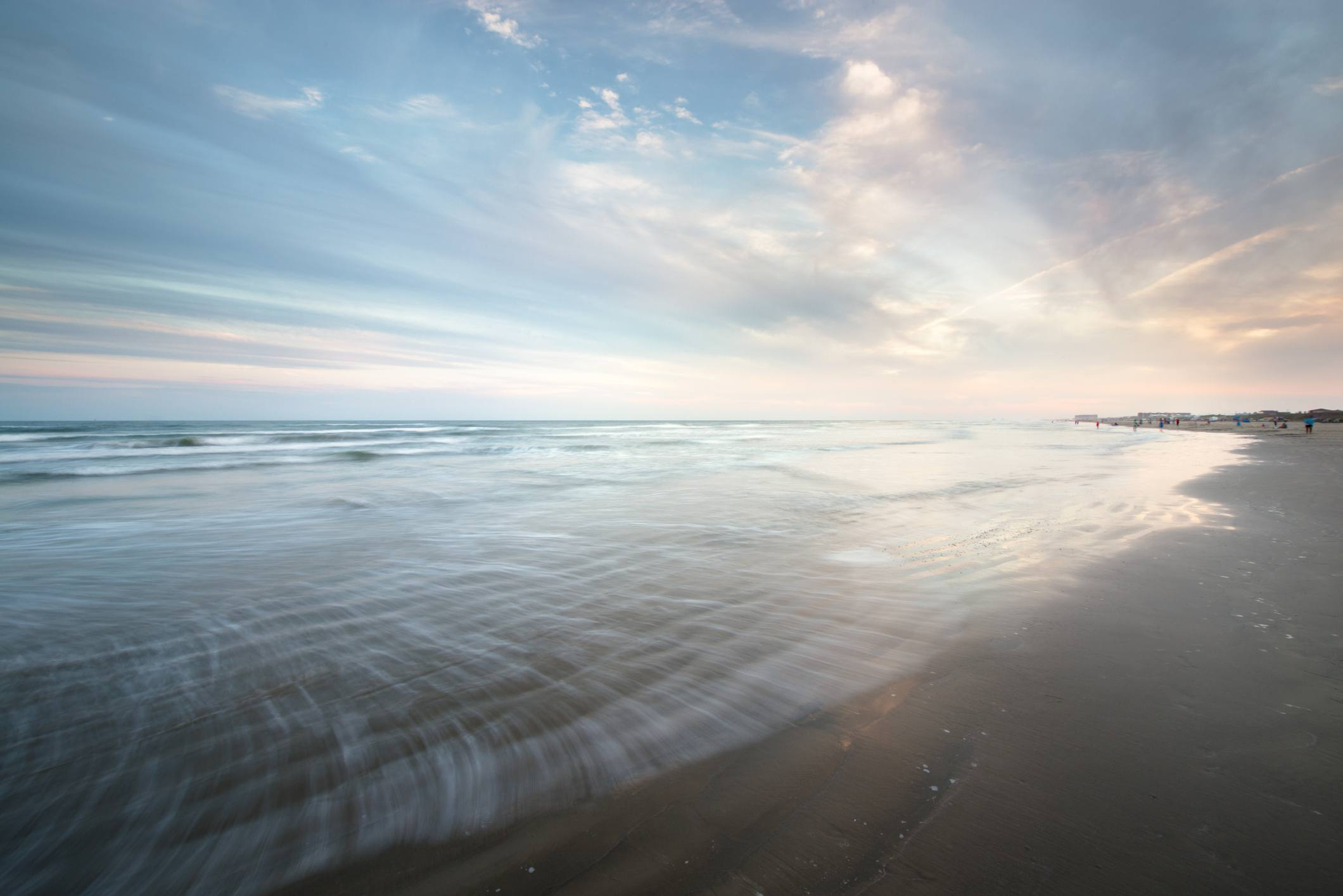 Smooth water at the beach in Port Aransas at sunset, Texas, USA