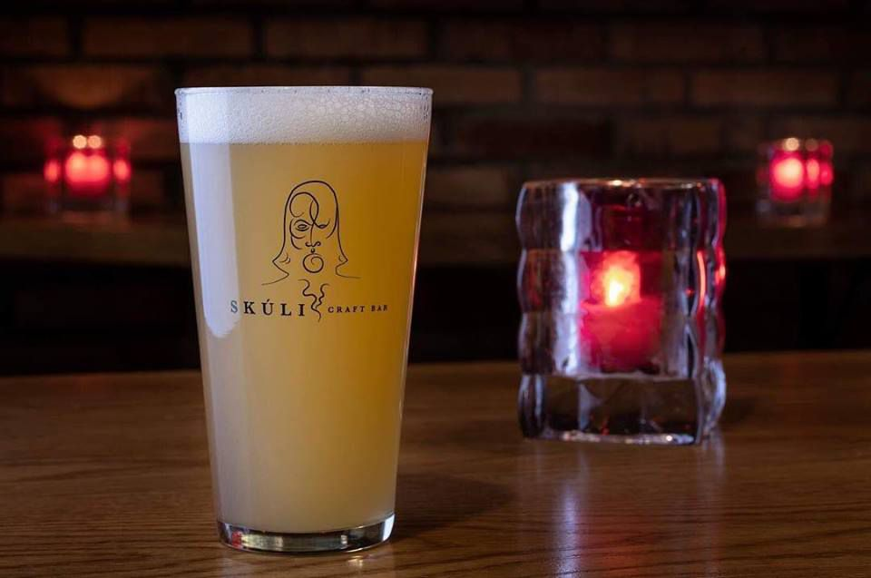 Glass of beer at Skúli Craft Bar with a candle next to it