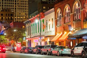 Cars parked along Sixth Street in Austin at night