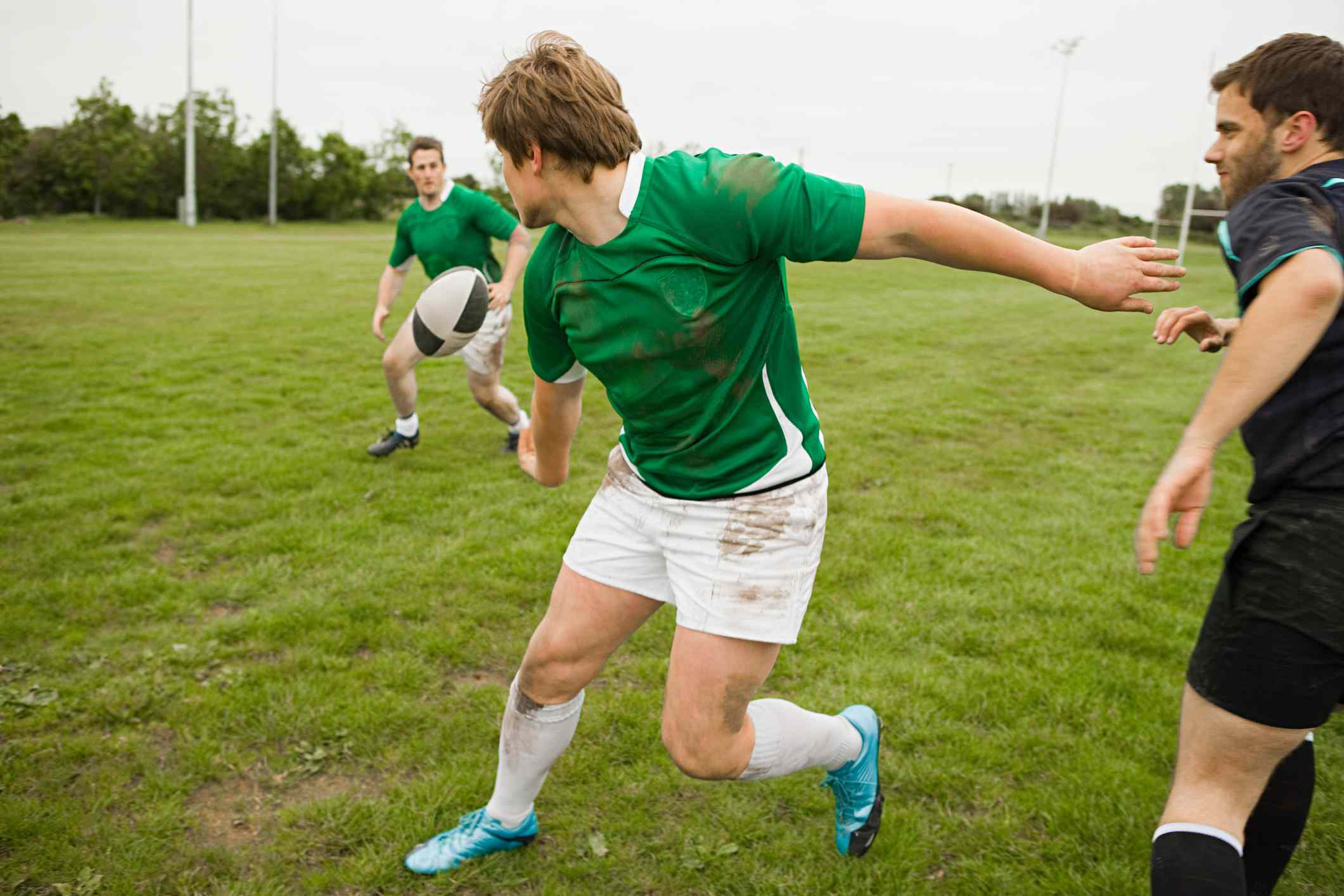 limerick rugby players pass ball