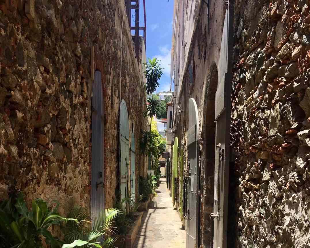 narrow alley with stone buildings in st. thomas