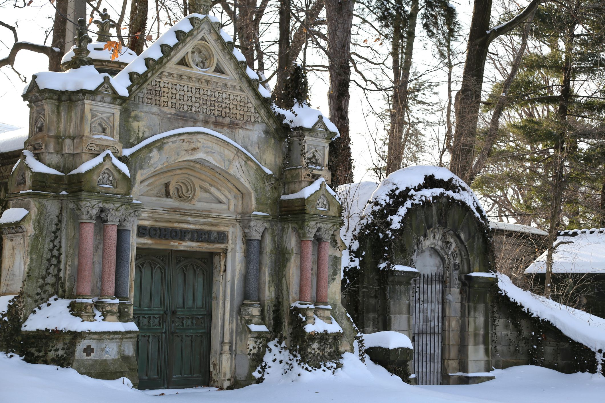 Mausoleums in the snow covered hillside, Lake View Cemetery, Cleveland, Ohio, United States