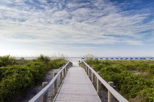 A wooden walkway heads towards the beach on Hilton Head Island, SC.