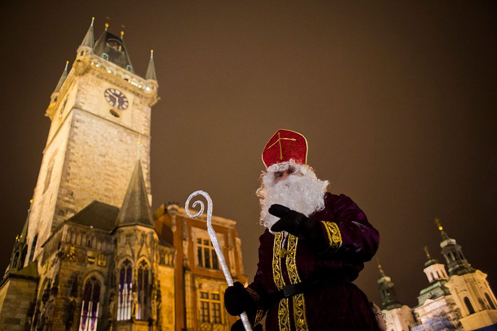 A man dressed as St. Nicholas stands at the Old Town Square on December 5, 2014 in Prague, Czech Republic