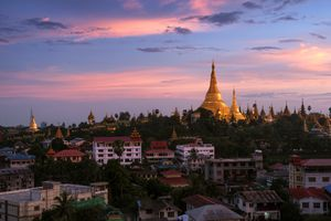 Golden Shwedagon Paya in Yangon, Myanmar at sunset