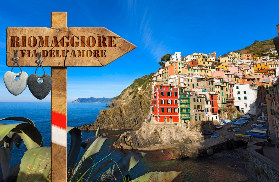 Wooden sign pointing in the direction of Riomaggiore, Cinque Terre