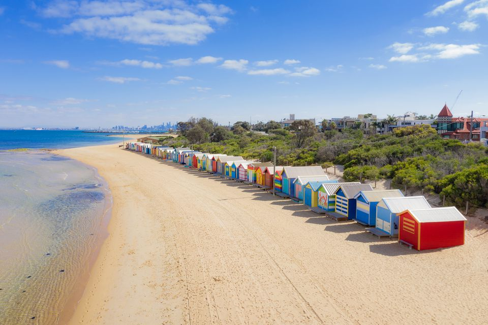 Aerial view of Brighton Bathing Boxes on white sandy beach at Brighton beach in Melbourne, Victoria, Australia.