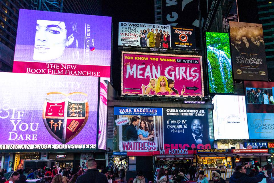 Broadway billboards lit up at night