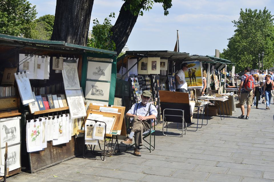 Vendor stands along walkway in Paris, France