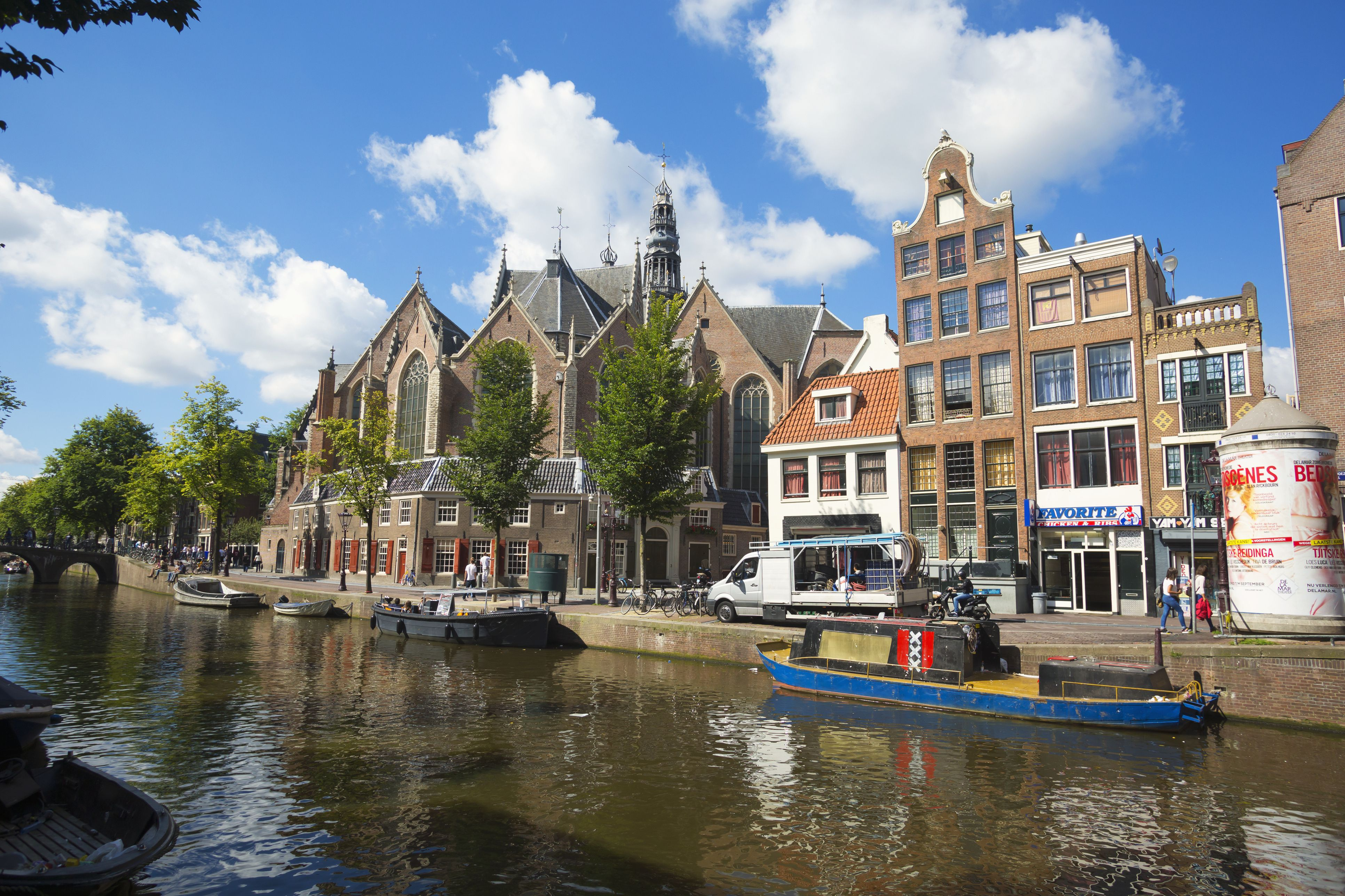 Canal in Amsterdam with the Old Church in the background; Amsterdam, Holland