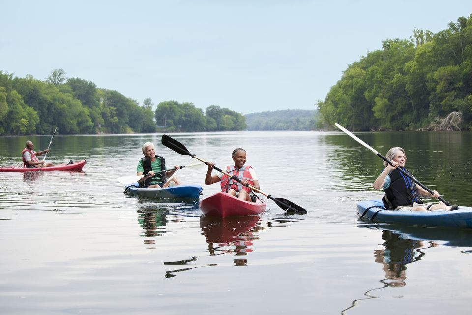 A group of seniors kayaking on a river