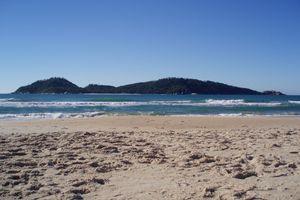 A clean, sandy beach with blue waves