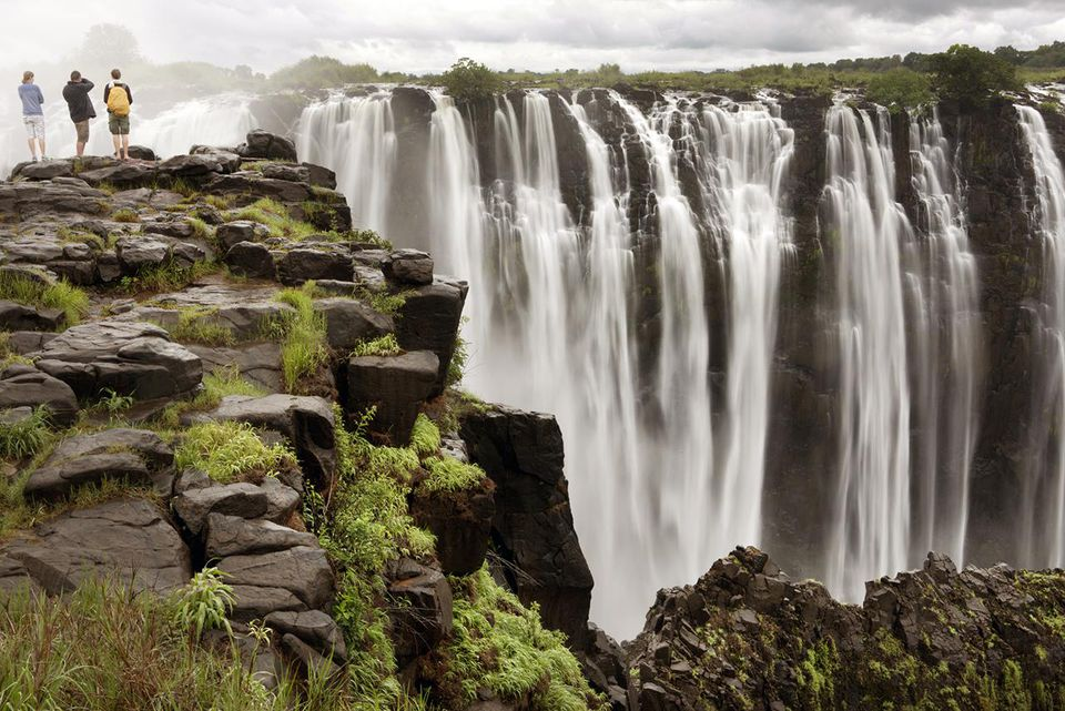 Three people looking at Victoria Falls, Zimbabwe