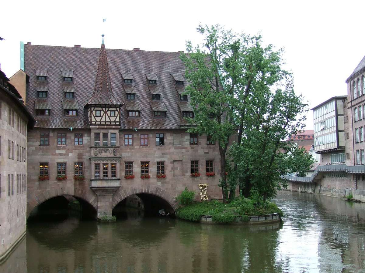 Holy Spirit Hospital on the river in Nuremberg in the summer