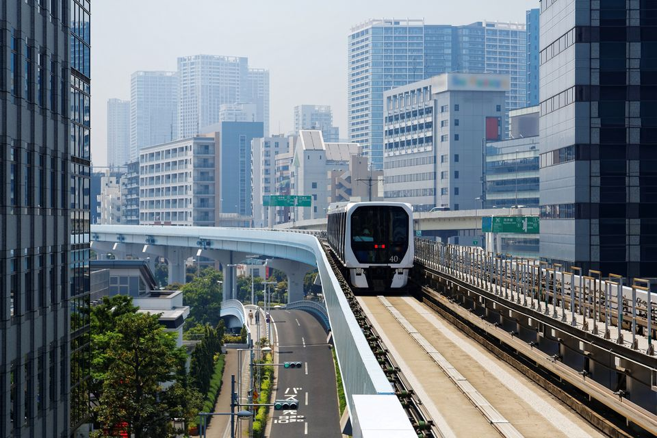 Metro train traveling on the elevated rails of Yurikamome Line